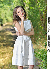 beauty girl in a fashioned dress in a forest