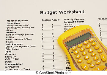 Creating your budget - A budget worksheet with a calculator,...