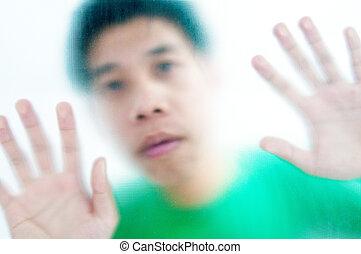 A man benind blur mirror