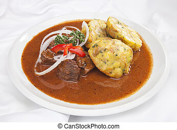 Hungarian goulash w dumplings and vegetable garnish