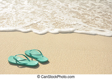 Green Flip Flops on Beach - Green Flip Flops on a Sandy...