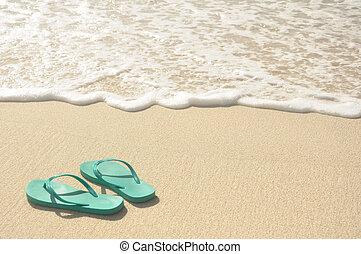 Green Flip Flops on Beach - Green Flip Flops on a Sandy...