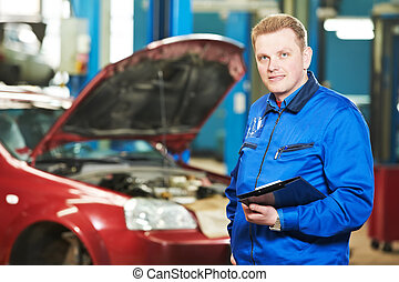 happy mechanic technician at service station - Smiling happy...