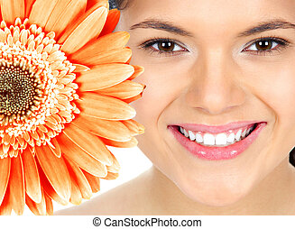 Beautiful woman smile with flower - Beautiful young woman...