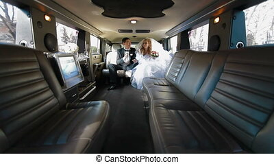 Just Married Couple Inside Limo - Just Married Young Couple...