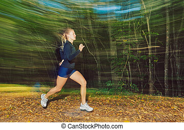 Runner - Young Woman Running on Trail with Motion Blur