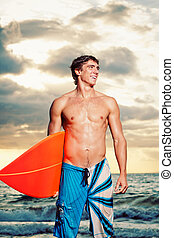 surfer - Professional Surfer holding a Surf Board