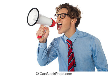 Young businessman using megaphone isolated over white...