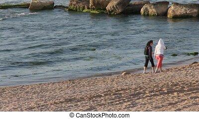 Walking along the sea