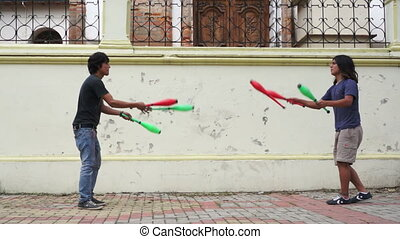 Two Street Jugglers Practicing - Two street jugglers...