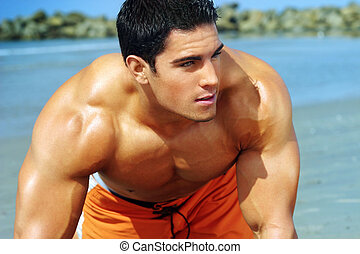 Young guy at beach - Portrait of a handsome young muscular...