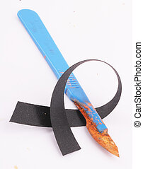 scalpel - A rusty scalpel with blue handle and black ribbon