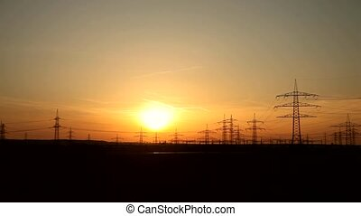 Sunset over Landscape With - Power Poles And Sunset