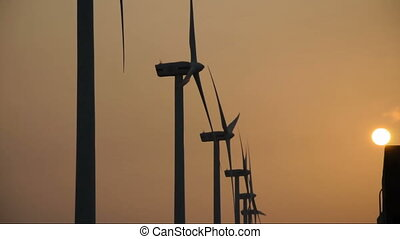 Wind generator with the sunset in the asia