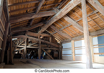 Barn inside - Wood framework and board of old barn inside in...