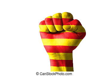 Fist painted in colors of catalonia flag - Low key picture...