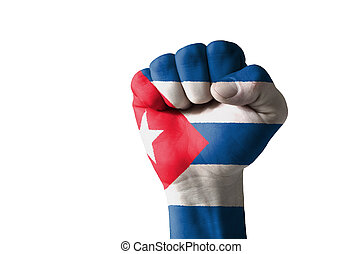 Fist painted in colors of cuba flag - Low key picture of a...