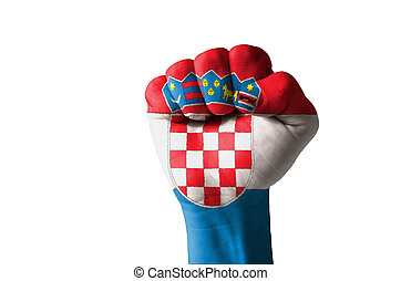 Fist painted in colors of croatia flag - Low key picture of...