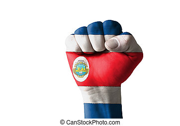 Fist painted in colors of costa rica flag - Low key picture...