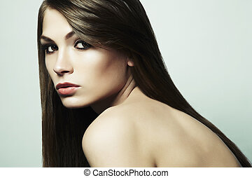 Fashion photo of a young woman with dark hair. Close-up...