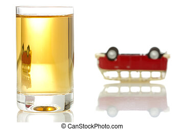 concept for drinking and driving. alcohol  and upended car.
