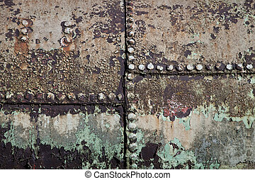 Riveted plates - Grungy old riveted metal plates covered in...