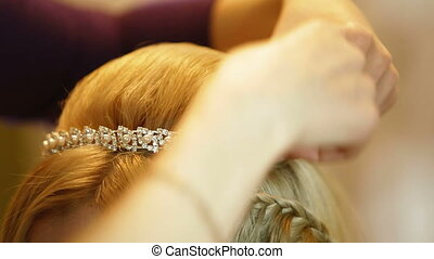 Bride Hairstyle - Hairdresser pinning up brides tiara before...
