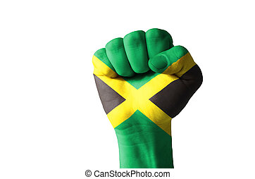 Fist painted in colors of jamaica flag - Low key picture of...