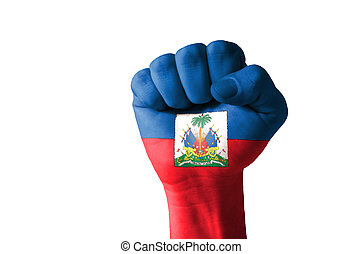 Fist painted in colors of haiti flag - Low key picture of a...