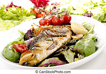 sea bass on a plate with fresh salad - grilled sea bass on a...