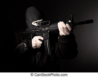 terrorist with rifle - portrait of criminal with m4 rifle