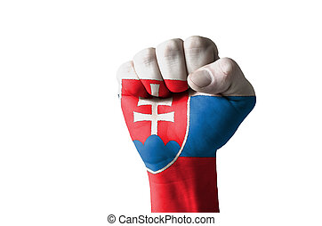Fist painted in colors of slovakia flag - Low key picture of...