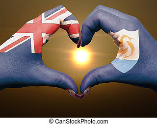 Tourist gesture made by anguilla flag colored hands showing...