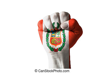 Fist painted in colors of peru flag - Low key picture of a...
