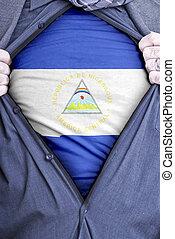 Nicaraguan Businessman - A Nicaraguan businessman rips open...