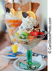 Ice-cream - Tasty ice-cream with tropical fruits, waffles...