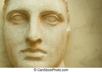Ancient face - Ancient sculpture close-up portrait at old...