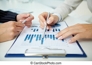 Business data - Close-up of a business document and business...