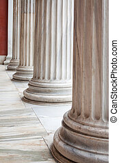 Classical Greek columns in a row - Closeup of row of...
