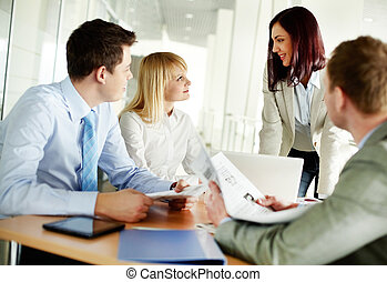 Latest business news - Successful business team holding a...