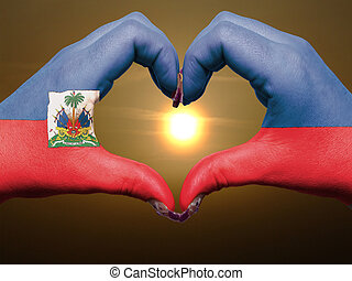 Gesture made by haiti flag colored hands showing symbol of...