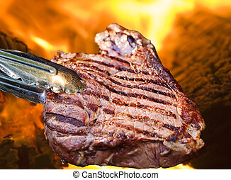 Barbecue Steak - Barbecue concept with a juicy steak in...