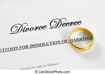 divorce decree - gold wedding ring on a divorce decree