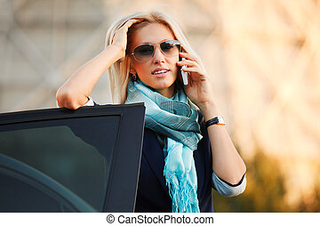 Female driver calling on the phone