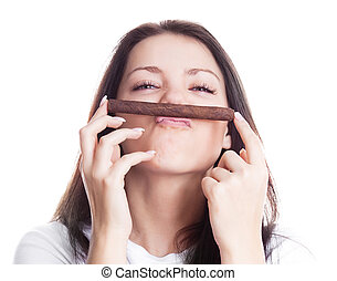 woman smelling a cigar - humorous portrait of a beautiful...