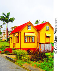 yellow house with palm trees - yellow house in the Barbados...