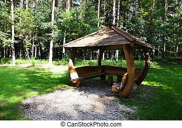 wooden arbor - The wooden arbor located in wood. Summertime...
