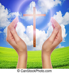 hands praying with cross in sky - easter concept - female...