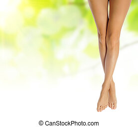 sexy female legs over green natural spring