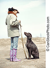 Dog training - Woman and dog training outdoors